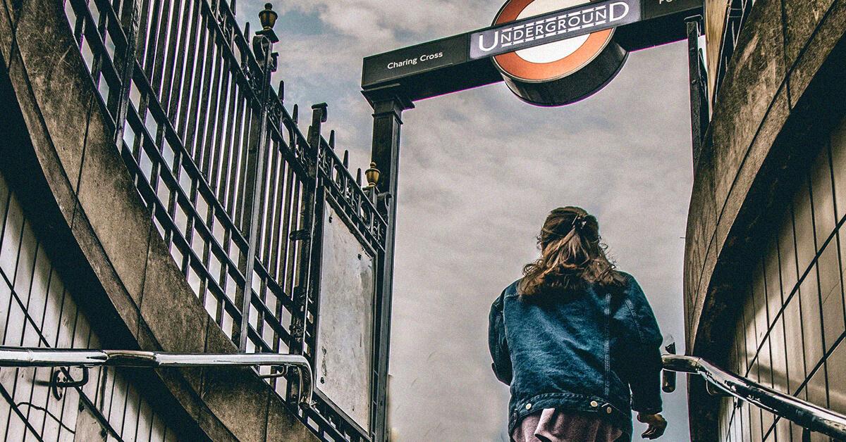 Girl walking up London underground