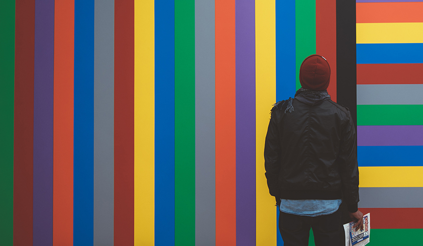 A man against a colorful wall