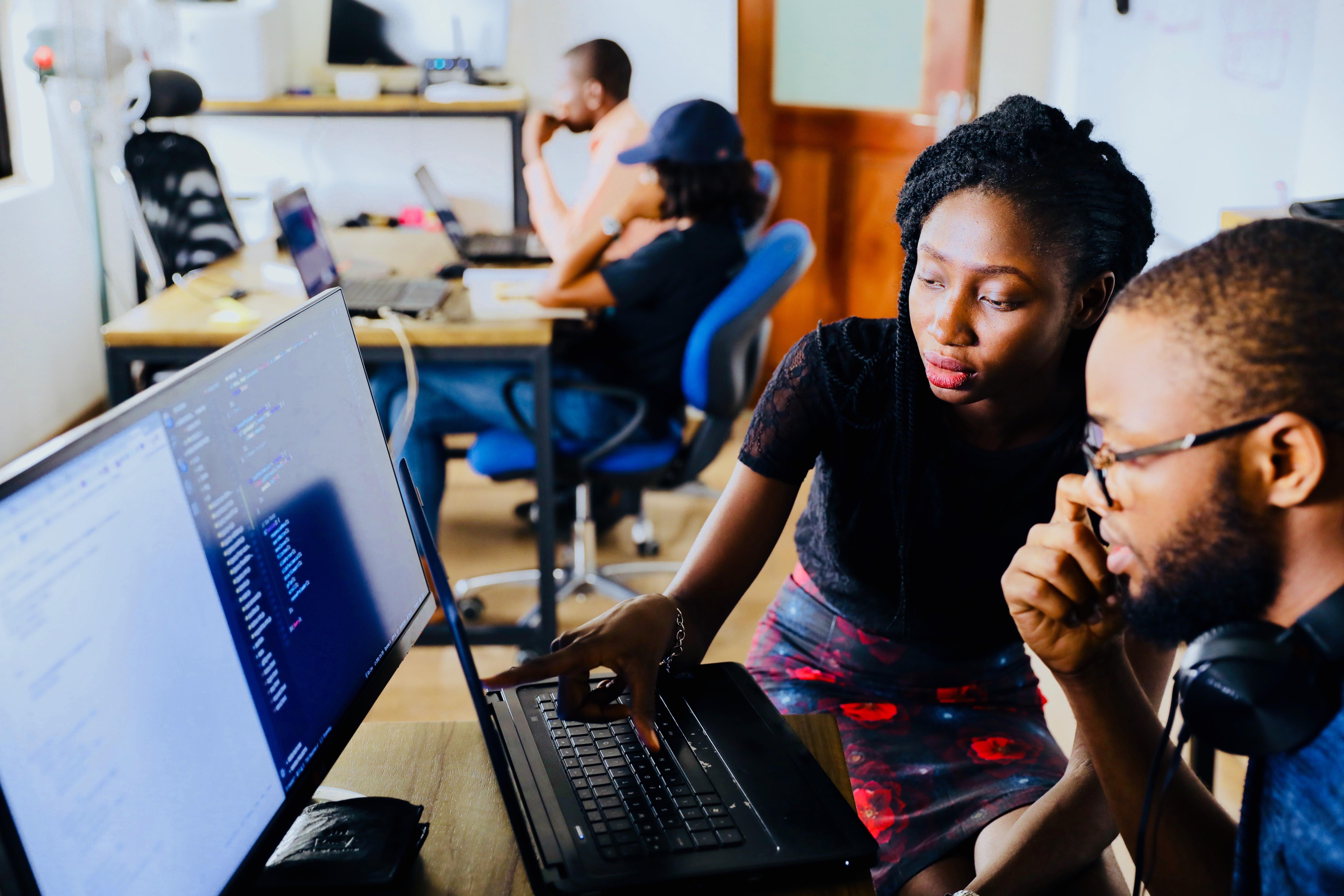 People behind laptop