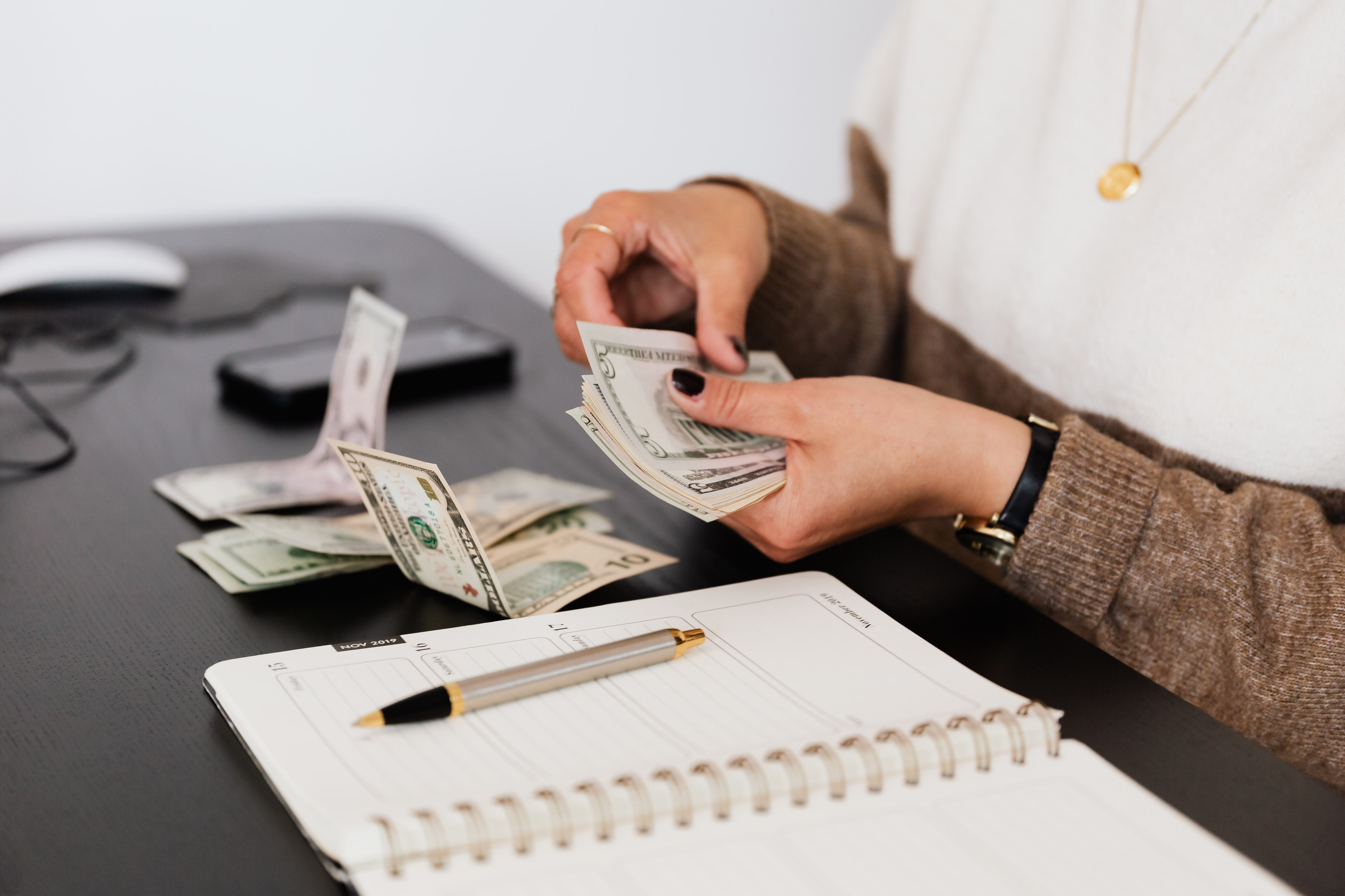 Woman counting her money, budgeting