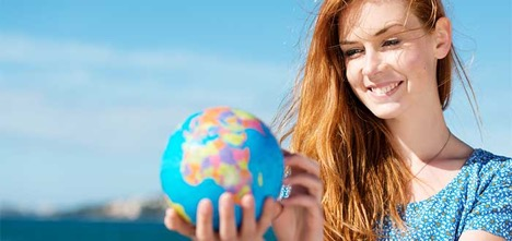 Woman holding a globe of the world