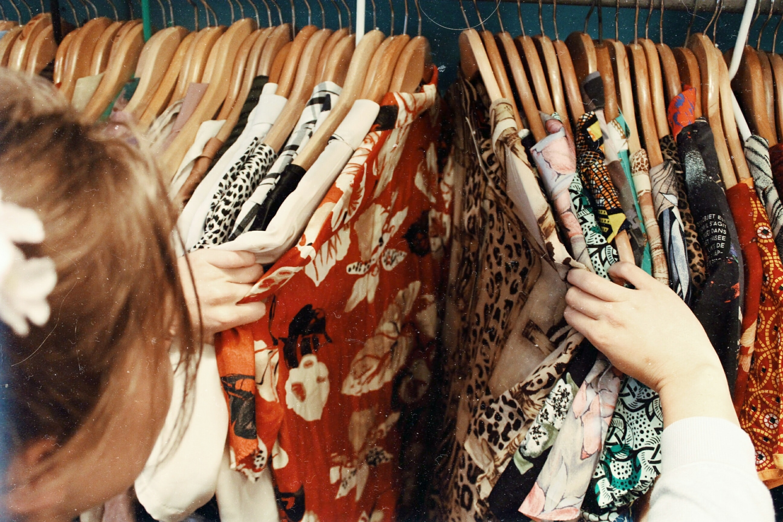 girl looking through clothes