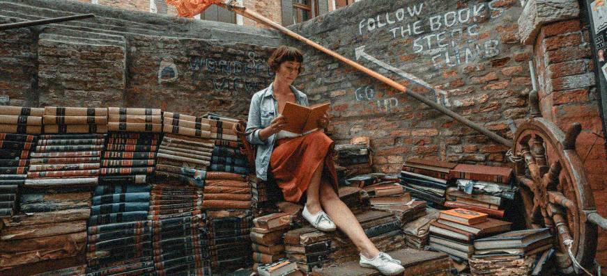 person reading book photo