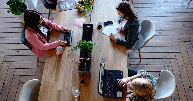 Women working on an office desk