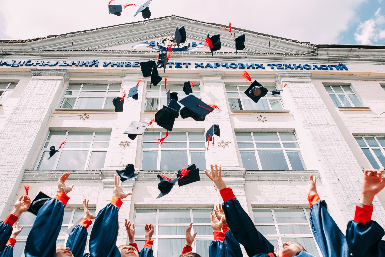 University graduates throwing hats