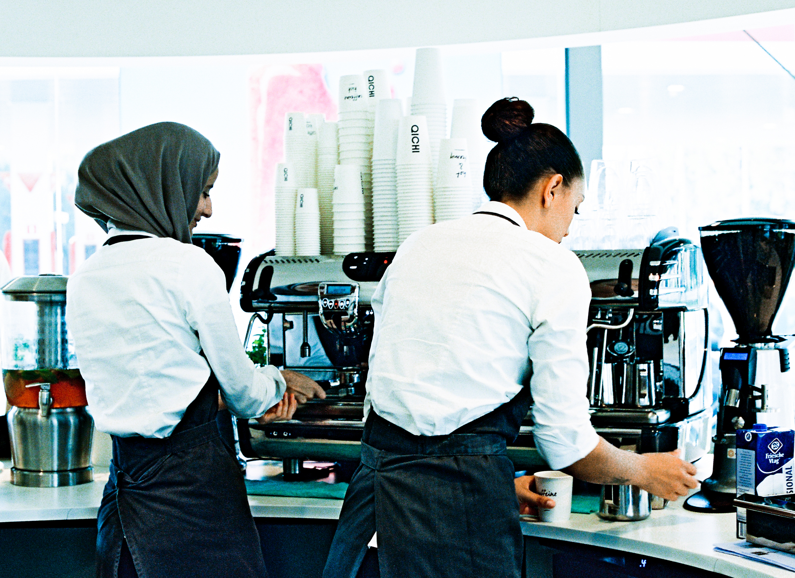 Two girls working in cafe